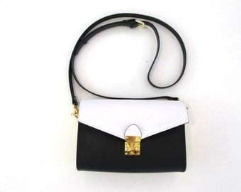 Handmade leather purse with removable strap. Available in many colors