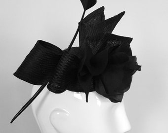 Women black pillbox hat with bow and feather detail