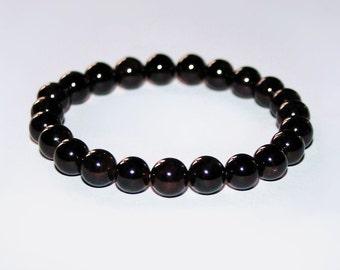 Garnet stretch bracelet. Woman Burgundy bracelet.