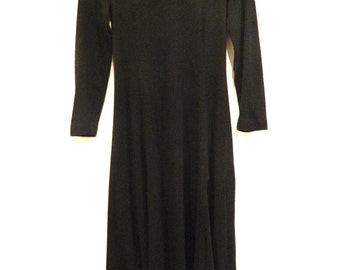 80's long sleeved black dress with side slit and shoulder pads