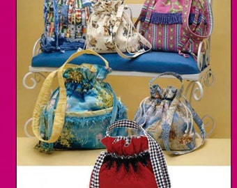 Drawstring Bags in Three Sizes 8x9, 11x14, 14x17, 15.5x15.5. Simplicity 3531. Desing by Faith Van Zanten Pattern is new and uncut.