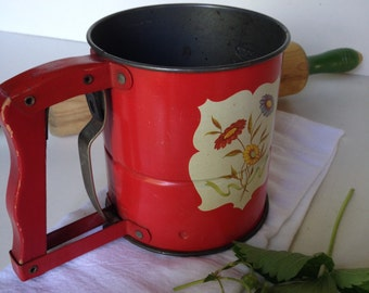 Mid Century Androck flour sifter vintage 1950s red with flowers and red wood handle from MilkweedVintageHome