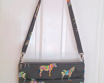 Rainbow zebras cross body bag, zip top, IPad / tablet bag
