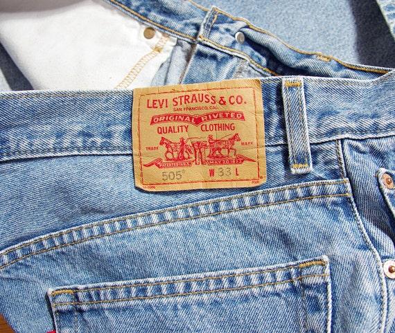 SALE! 90s LEVI'S 505 mens light blue denim jeans shorts / size W33