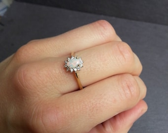 Diamond & Opal Engagement Ring in Gold