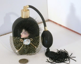 Black glass perfume mister with lady cameo and diamond motif, very lovely.