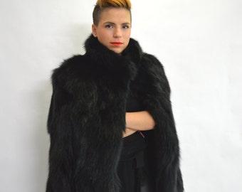Real fur coat, black fox fur coat, genuine fox fur jacket. Genuine fox fur pelt. Black jacket, black fur jacket. Black fox fur collar.