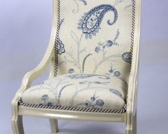 Price Reduced!  Reupholsted vintage Victorian nursing chair.  Painted white, blue paisley & ticking fabric, fringed pillow.