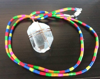 Gorgeous handmade tribal necklace with handwrapped clear quartz
