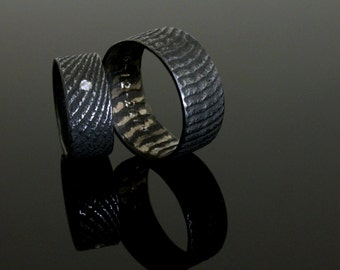 Black silver wedding ring, made with the melting with cuttlefish bone, oxidized
