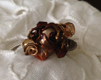 GR30B  Amber fresh water pearl ring, size 6 1-2, wrapped in bronze wire