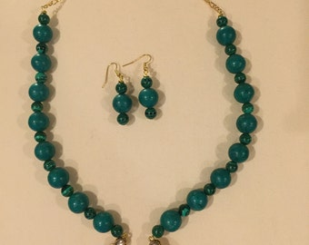 Turquoise with Gold Tone Pendant Necklace
