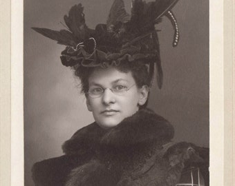 Portrait of young woman with elaborate plumed hat