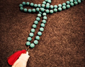 Knotted Turquoise Bead Necklace with Bone Hamsa & Tassel
