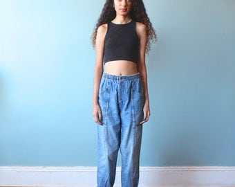 High waisted faded blue distressed jeans / 1980s / xs-small