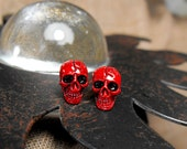 Tiny skull studs in red. Unisex earrings. Surgical steel