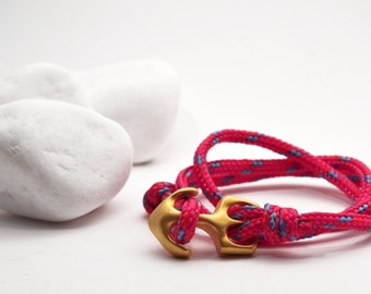 Triple row fuchsia rope bracelet with gold anchor clasp, nautical