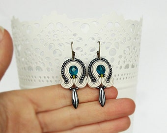 White beaded soutache earrings with blue crystals and dark silver details