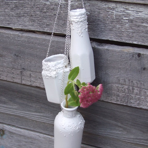Hanging planter wall vases on silver plated chains. Porcelain ceramic vases to hang from garden and indoor walls. Wedding gift/decorations.