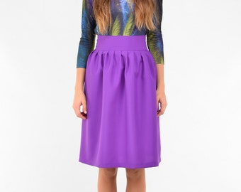 Purple knee length skirts with pleats