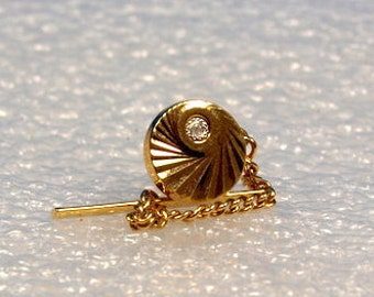 Tie tack , round, gold metal, swirl etching, clear stone, chain, vintage, retro