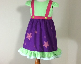Little Charmer Dress in purple with stars