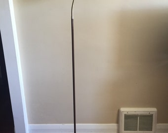 A Mid Century Modern Industrial Style Floor Lamp by Lyskaer. Danish Design Made in Canada.