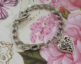 Silver Metal Filigreed Heart Charm Bracelet with Heart Toggle Clasp on 7.5 Inch Double Link Silver Metal Chain