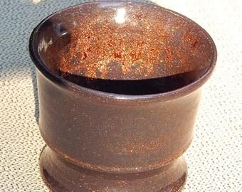 Copper colored chalice or vase