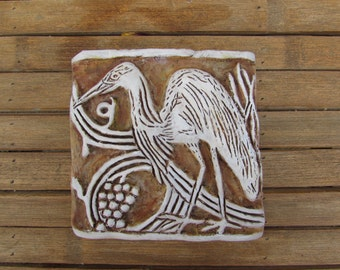 Graceful Egret Bas Relief Tile, inspired by the  tiles of the Bachelder and Malibu Potteries era, grapevine connects a grouping...