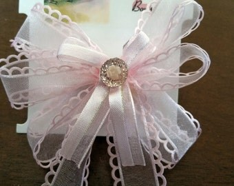 Pretty pink hair bow with beautiful embellishment