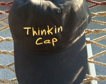"""Thinkin Cap - Black w/Gold Lettering - Reverses to say """"Not Thinkin"""" on the back"""