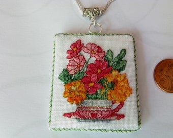 Cross Stitch Pendant. Flower Pendant. Teacup Pendant. Pendant Necklace. Hand stitched Necklace. gold and pink flowers.  pink teacup. -x50