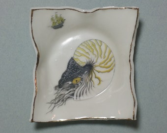 Porcelain Nautilus & Sailing Ship dishes with gold detail. Hand drawn illustration. Hand sculpted ceramics. Unique and handcrafted.