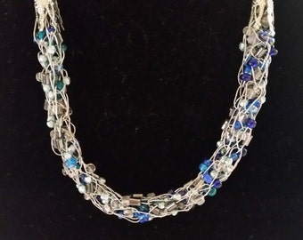 Captured Blue Tone And Clear Bead And Wire Netting Necklace