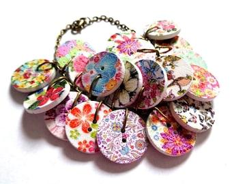 Bronze tone, bronze charm bracelet wooden buttons spring white coloured