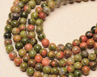 1 Strand of 4 mm round Unakite beads   (#J1478)