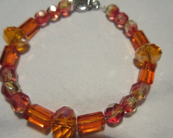 Orange and A/B Glass beaded bracelet