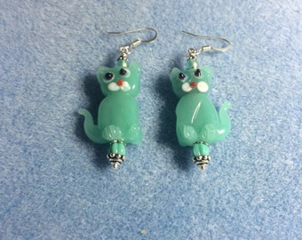 Milky turquoise lampwork cat bead earrings adorned with turquoise Czech glass beads.