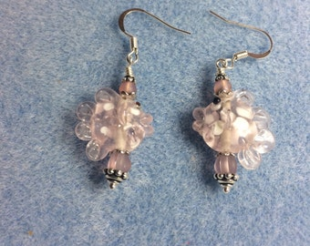 Pink lampwork fish bead earrings adorned with pink Czech glass beads.