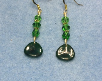 Kelly green Czech glass rose petal dangle earrings adorned with kelly green Czech glass beads.