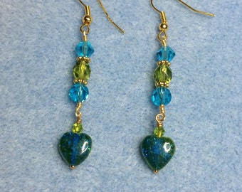 Turquoise and olive green Czech glass heart dangle earrings adorned with turquoise and olive green Czech glass beads.
