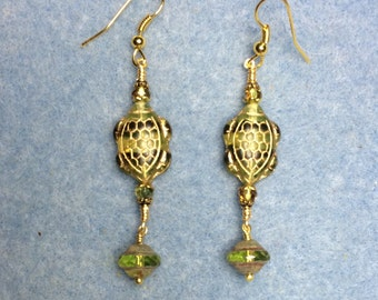 Olive green and dark green Czech glass turtle bead earrings adorned with olive green Saucer beads and olive green Chinese crystal beads.