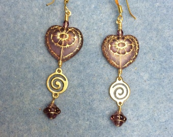 Violet with gold inlay Czech glass heart bead dangle earrings adorned with gold swirly links and violet Saturn beads.