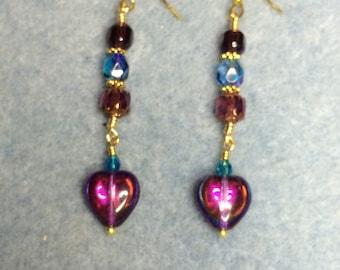 Metallic blue purple Czech glass heart earrings adorned with blue and purple Czech glass beads.