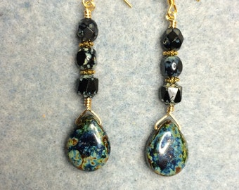 Blackish green Czech glass briolette earrings adorned with black Czech glass beads.