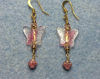 Pink glass butterfly bead earrings adorned with pink Chinese crystal beads and small pink Saturn beads.