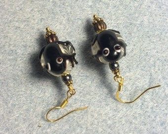 Brown lampwork frog bead earrings adorned with brown Czech glass beads.