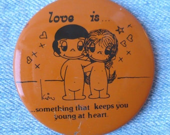 Vintage Love Is Kim Pinback Button 1970 Orange pin Young at Heart