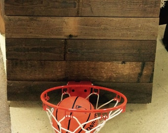 Small basketball goal made from reclaimed pine flooring